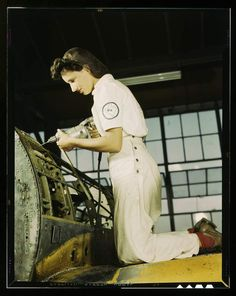 (Courtesy  |  Library of Congress) Oyida Peaks riveting as part of her NYA training to become a mechanic in the Assembly and Repair Department at the Naval Air Base, Corpus Christi, Texas. Aug. 1942.