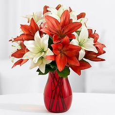 Royal Holiday Lilies with Red Mason Jar and other flowers & plants at ProFlowers.com