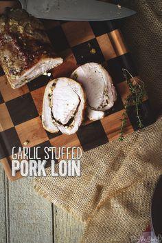 This garlic stuffed pork roast is loaded with flavor. Pork Roast Recipes, Rib Recipes, Dinner Recipes, Healthy Recipes, Pork Loin Ribs, Holiday Recipes, Holiday Meals, Stuffed Pork, Smoking Recipes