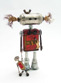 """This sculpture """"Dolly Dimple"""" is one of very few Fobots not for sale. By Raleigh artist Amy Flynn (via Amy Flynn Designs) Recycled Robot, Recycled Art, Arte Robot, Robot Art, Found Object Art, Found Art, Metal Robot, Art Sculpture, Metal Sculptures"""