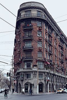 The Wukang Mansion or Wukang Building (Chinese: 武康大楼), formerly known as the Normandie Apartments or International Savings Society Apartments, is a protected historic apartment building in the former French Concession area of Shanghai. It was designed by the Hungarian-Slovak architect László Hudec and completed in 1924. The building has been the residence of many celebrities.