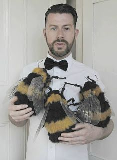 MR. FINCH holding his bumble bee creations