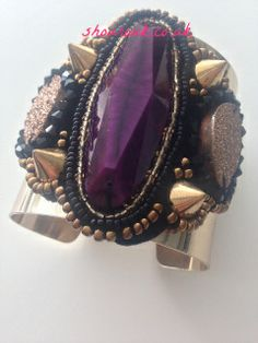So Gorgeous Punk Rock Purple   Gold Cuff with Large Purple Centre  Stone with Four Gold Spikes and Black   Beads  A Must Have accessory  !