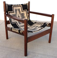 "#pendleton #midcentury A rare and beautiful Mid Century 'Roxinho' chair, designed by French designer Michel Arnoult in the 1950s, and made in Argentina.  Solid teak frame has a gleaming rosewood finish.  Sling is made of heavy, soft Pendleton wool in a graphic, black and off-white Navajo pattern.  Backed with heavy-duty, natural-colored canvas for durability and comfort.  Professionally refinished and reupholstered. Measures 27"" long, 27"" wide, and 29.25"" tall. Local pick up i..."