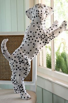 """Card Deck Papermache Dalmatian. Link takes you nowhere. Dal was sold on Wisteria with this description """"This little Deck of Cards Dalmatian is a paper mache delight. His dalmatian coat is made from what appears to be a deck or two of club and spade cards. He'll happily stay anywhere you place him."""""""