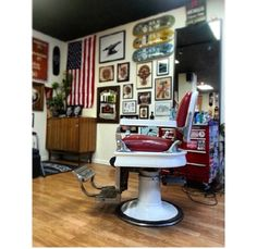 Red and white barbers chair, with red portable tool station and cool decoration around the barbershop.