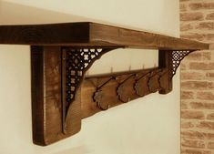 Rustic Wall Mounted Coat Rack by JetoriArts on Etsy https://www.etsy.com/listing/237948100/rustic-wall-mounted-coat-rack
