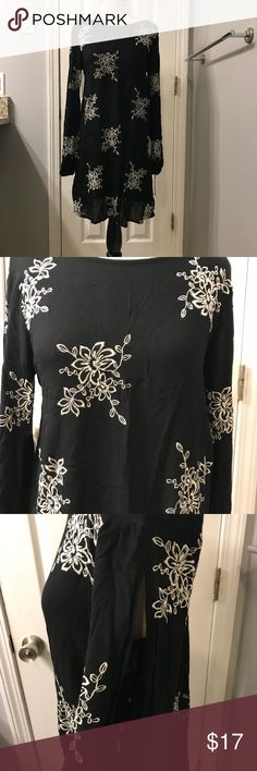 Xhilaration Tunic Top Black White Boho Sz M NWT! - Black with white embroidered flowers - Cris Cross in back - Long Sleeve - Open slits in sleeves - 35 in. length shoulder to hem - 20 in. arm pit to arm pit - 100% Rayon  Items are shipped within 1 business day of payment Monday - Friday. Items paid for on the weekend or holiday will be shipped the next business day.  Thanks so much for looking!! Xhilaration Tops Tunics