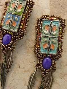 These cute little earrings are just perfect for any occasion. Enamel tops with dyed purple jade below and just the right amount of feathers.