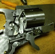 "Nicely documented below are some photos of the building process behind making a .22 copy of a Webley break-top revolver. This firearm was made entirely from scratch using some basic machine tools. ""Bar stock with paper templates I made"" ""Block of wood for test fitting of the components of the action"" ""The pivot of the … Read More …"