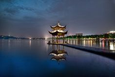 Pagoda reflection by César Asensio on 500px