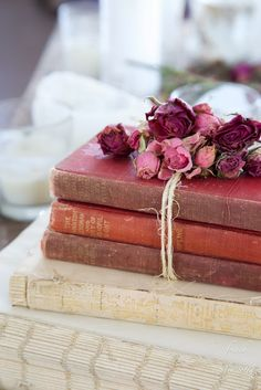 Little touches like this with the rope string tied around some old books along with the pretty blooms on top, can add a charming touch to any living space.