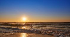 Surfer enjoying the early morning waves at Sunshine Beach, QLD, Australia