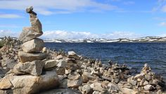 ROCK CAIRNS // © Kris Defour // Sun, snow and solitude on a hike through the high mountain plateau of Hardangervidda, Norway's largest national park. Whenever we were at a particularly nice vista, there would always be little piles of stones. Just a nice way to put a mark in a place, and say 'I was here'.