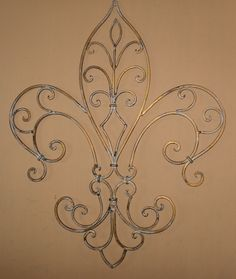 Metal Wall Decor / Wrought Iron / Fleur de lis Wall Decor/ Wall Hanging / Shabby Chic /Gold Antique Finish / Shabby Chic Decor. $34.00, via Etsy.