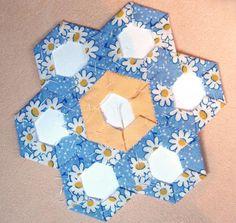 Hand sew flowers…grandma's garden quilt Hexagon Quilt Pattern, Hexagon Patchwork, Quilt Patterns, Quilting Ideas, Making Fabric Flowers, Flower Making, Crocheted Flowers, Burning Flowers, Bargello Quilts
