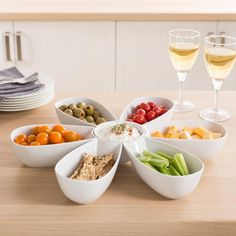 Our flower shaped Flora Serving Bowl set is the perfect way to serve fruit, veggies, antipasto or chips. Individual serving bowls can be placed around a central dip bowl to create a stylish and unique display. Simple white porcelain bowls compliment any decor while being durable enough for indoor or outdoor use.