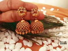 Beautiful jumkhis with peacock design. Jumkhis with pumpkin hangings. Gold Jhumka Earrings, Jewelry Design Earrings, Gold Earrings Designs, Jhumka Designs, Gold Mangalsutra, Gold Necklace, Ruby Earrings, Indian Gold Jewellery Design, Gold Bangles Design