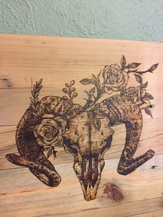 Ram skull with roses I burned. Pyography