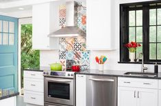Check out one of our favorite kitchens featuring the in stock Random Patchwork tiles! This dream kitchen was completed by Cement Tile Backsplash, Kitchen Backsplash, Kitchen Cabinet Styles, Kitchen Cabinets, Patterned Kitchen Tiles, Patchwork Tiles, Farmhouse Style Kitchen, Tile Patterns, Kitchen Remodel