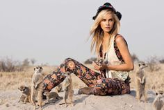 Like the outfit but the true scene stealers are the meerkats. They work it!