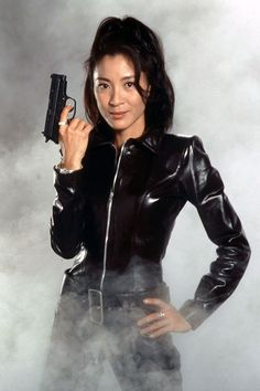 James Bond anniversary: pictures of the best loved Bond Girls from the James Bond films - Photo 16 Soirée James Bond, James Bond Women, James Bond Party, James Bond Movies, Michelle Yeoh, List Of Bond Girls, Best Bond Girls, Roger Moore, Sean Connery