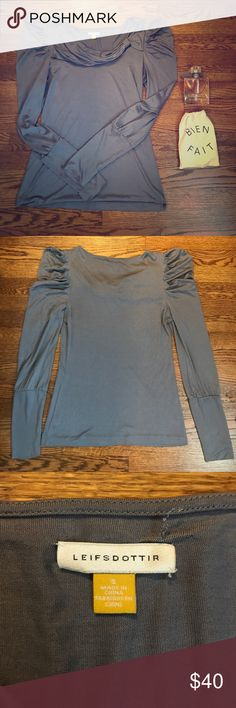 Anthropologie Leifsdottir 100% Silk Blouse - Gray Classy and Luxurious 100% Silk Top from Leifsdottir. Soft material, incredibly comfortable. Fitted. Puffed shoulder, asymmetrical neckline. Tag is detached on interior on one side (see photos) with small snag. Cannot be seen from exterior. Smoke free, pet free home! **perfume and pouch not included** Anthropologie Tops Blouses