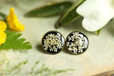 This dainty pair of real flower earrings were made using a sprig of snowy white Queen Annes Lace which I set in resin against a black background.  These earrings measure about 14mm across and are made of nickel-free bronze, resin & real flowers from my wanders about the Irish