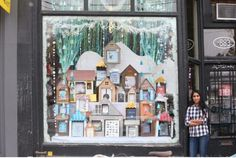 Window display designer Kalpna Patel in front of her window design at Type Books on Queen St.