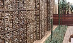 Full gabion wall with relief panels