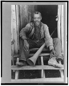Old Negro (former slave) with horn with which slaves were called, near Marshall, Texas Photogrammar