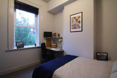 Small room. Key items include bed, desk and chair. Photo frame for personalisation. Basic but achievable.