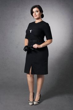 Star, black round necked dress with front slit and feature star centre chest area  http://www.dealondon.co.uk/star-black-crew-neck-dress