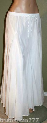 Love this flowy white skirt, Will match everything. Perfect for day or night this Summer.
