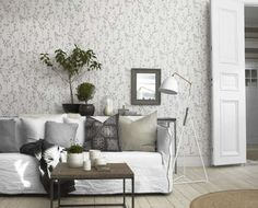 nice gray color combos and patterns with white couch.  I like the table behind the couch to add accents, and lighting.