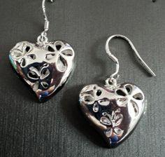 Price: $15 Delicate dangle sterling silver heart earrings have 2 butterflies and a flower. Get a pair for yourself, give as a gift, or both! Reg. $25