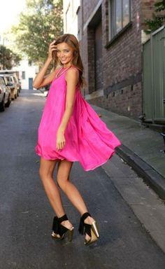 Victoria Secret Angel Miranda Kerr...love the pink dress paired with black heels!