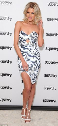 Grrrh! Erin Holland put on a glamorous display at the launch of Superdry's new flagship st...