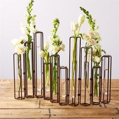 Lavoisier Set of 10 Hinged Flower Vases with Antiqued Rusted Finish. Heights vary for each vase as well as the bracket holding the vases. This beautiful hinged vase will add a very unique touch to any table. Flowers not included. Flower Vase Design, Flower Vases, Floral Design, Antoine Laurent, Rusted Metal, Two's Company, Vase Shapes, Burke Decor, Farmhouse Chic