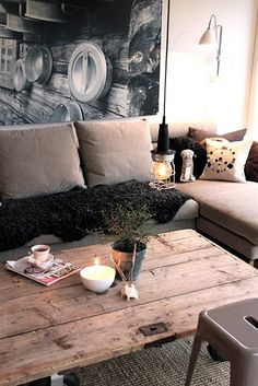Wooden door for a rustic coffee table, love the light.  ~LaurenCFarkas Interior Design Inspiration Board~