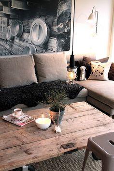 Wooden door for a rustic coffee table, love the light.  ~LaurenCFarkas Interior Design Inspiration Board~