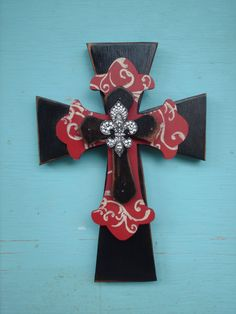 "The bottom cross was cut from 3/4"" wood.The other two were cut from 1/2"" wood.It has been painted, sanded and stained for a rustic look.It has a rhinestone brooch which has been attached to the top cross.It has been sealed and hangs by a sawtooth hanger. It measures 7 1/2"" W x 11"""
