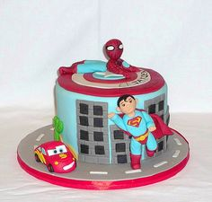 Bespoke Superheroes cake with Spider-Man, Superman and lightning McQueen birthday cake by EvaRose Cakes