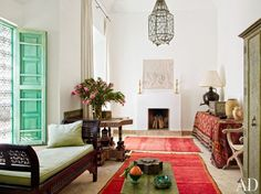 This Marrakech home once belonged to Chilean artist Claudio Bravo. It still boasts a colorful, creative atmosphere, with vibrant rugs from Morocco, a Kurdish kilim draped over a table, and a star-shaped side table. Moroccan Interiors, Architectural Digest, Decor, Shabby Chic Living Room, Chic Living Room, Home, Interior, Morrocan Decor, Home Decor