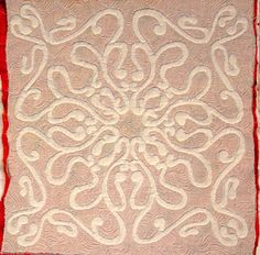 These scrollwork trapunto examples show shadow trapunto (white on red background), McTavish
