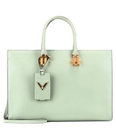 Valentino - My Rockstud leather tote - Valentino's 'My Rockstud' tote has a structured shape and fresh colour for the new season. The pastel-green leather is accented with gold-tone hardware while the roomy interior keeps it practical for your busy days and long-haul flights. The zipped top separates when open for full-accessibility and easy organisation. Style with other pretty pastel shades. seen @ www.mytheresa.com
