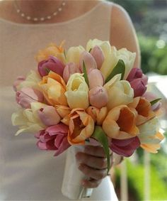 pink, orange, and pale yellow bouquet of tulips for a Spring wedding