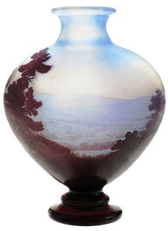 IMAGE: A Galle etched Cameo art glass landscape decorated vase, French, early 20th century, flared rim and oblong body, leaves in foreground in rich purple tapering to pale blue background