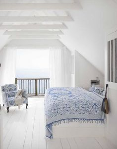 White floors, white walls, white and blue bedding = bliss! For soft cotton bedding and bedspreads take a look at www.naturalbedcompany.co.uk