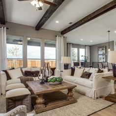"""""""Wrapping couches and ottomans around your living room table adds plenty of seating for entertaining guests."""""""